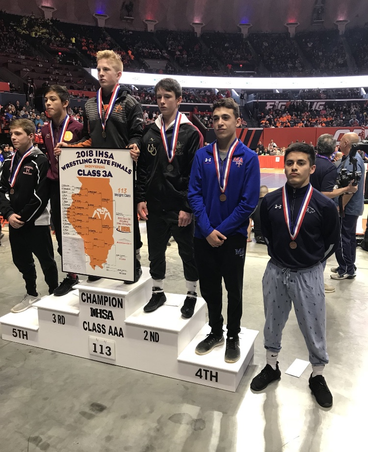 Junior Enzo Silva (right) places sixth in the state in the 113 lb. weight class (3A).