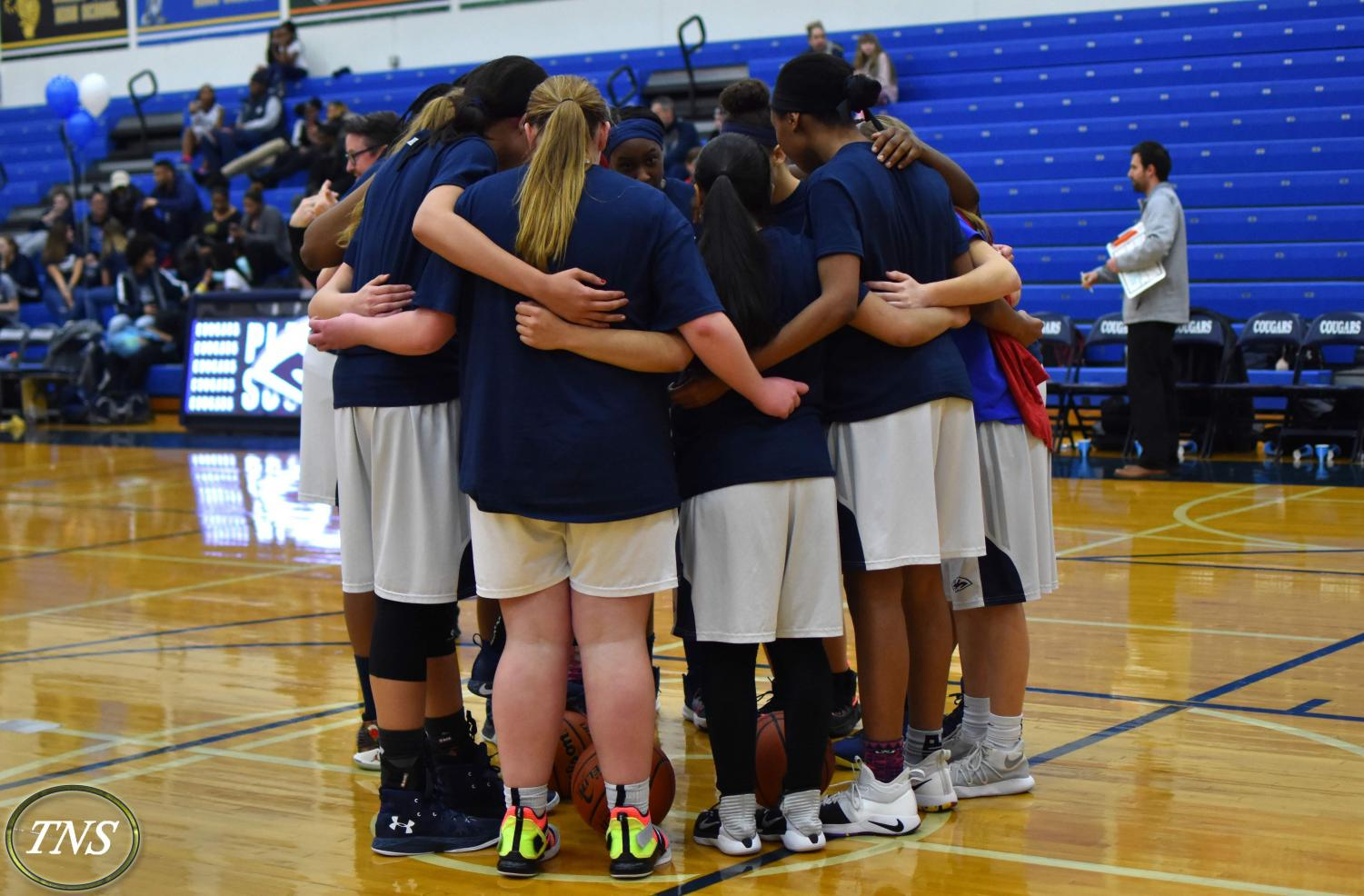 These photos feature last year's team huddle before the game against East.
